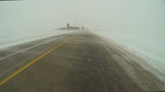 A Point of View Drive (POV) in blowing snow causes whiteouts - stock footage