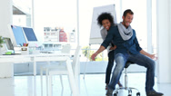 Stock Video Footage of Girl pushing her co worker on a swivel chair