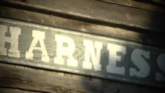 Western Historical Re-enactment - Horse Harness Shop sign Pan Stock Footage