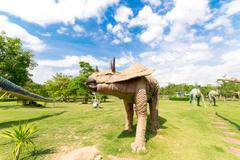 public parks of statues and dinosaur - stock photo