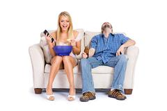 couple: guy bored with watching chick flick movie - stock photo