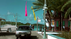 Antigua st. john's 025, a street to the waterfront, a cafe, colored flags Stock Footage