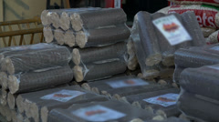 Large sized briquettes arranged into packages - stock footage