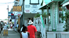 Antigua st. john's 032, tourists are going along typical caribbean houses Stock Footage