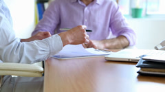 Businessman signing a contract and shaking hands with businesswoman Stock Footage