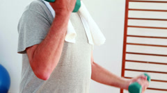 Senior man lifting hand weights Stock Footage