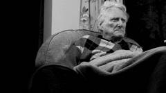 B & W Migraine - Elderly man watching Telly dolly - stock footage