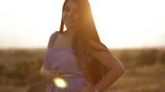 Pretty brunette in sunset light Stock Footage