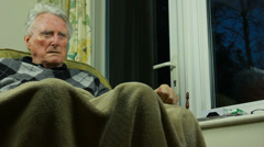Migraine - Elderly man watching Telly dolly shot - stock footage
