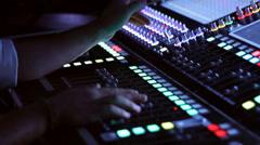 Audio Engineer running an audio console Stock Footage