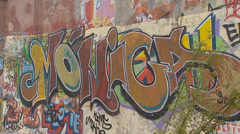 BERLIN WALL graffiti close up + pan Stock Footage
