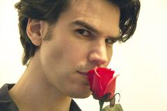Man Smelling A Rose - stock photo
