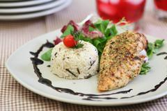 Chicken breast with long grain white rice Stock Photos