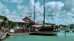 Antigua st. john's 064, pier, old sailing ship, wooden bridge, typical building Stock Footage