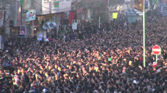 Crowds of muslim men touch head in religious parade, Ashura in Iran Stock Footage
