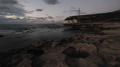 Tilting shot of Rosh Hanikra cliff during sunset Stock Footage