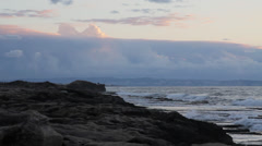 Sea and clouds during sunset, pan with boats and islands. - stock footage