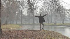 Happy excited man is throwing golden leaves in park after having big success. Stock Footage