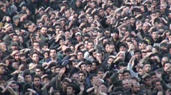 Crowd of muslim men take part in sombre religious parade, Ashura in Iran Stock Footage
