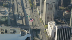 American Flag on Office Building in Urban Downtown Area - Aerial 1 - stock footage