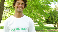 Handsome volunteer smiling at the camera Stock Footage