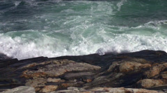 Waves surging onto the rocky coastline Stock Footage