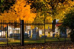 autumn colors and a fence at the gettysburg national cemetary, pennsylvania. - stock photo