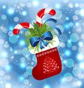 Stock Illustration of christmas sock with sweet canes