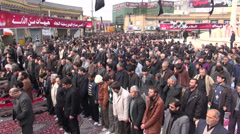 Iran, public prayer session during Ashura commemoration, crowd on square Stock Footage