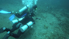 Scuba divers muck diving - stock footage
