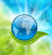 Planet earth with green leaf Stock Illustration