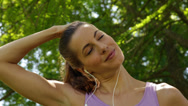 Stock Video Footage of Runner stretching neck listening to music in the park