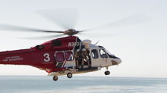 Rescue Helicopter Hoists Paramedic Stock Footage