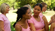 Stock Video Footage of Happy women in pink for breast cancer awareness in the park chatting