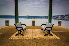 benches on the waterfront in alexandria, virginia. - stock photo