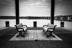 Benches on the waterfront in alexandria, virginia. Stock Photos
