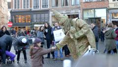 Living statue and little girl, Bruges, Belgium Stock Footage