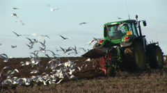 Tractor ploughing a field in England Stock Footage