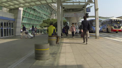 Outside Incheon Airport Passengers Walking Past Stock Footage