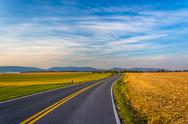 Stock Photo of country road and distant mountains in rural frederick county, maryland.