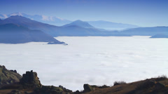 Timelapse scenery with dense layer of fog among mountain peaks Stock Footage