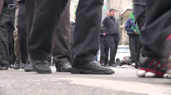 Ashura in Iran, walking through streets, feet and legs, low angle Stock Footage