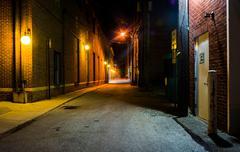 dark alley at night in hanover, pennsylvania. - stock photo