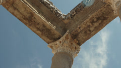 Stock Video Footage of Greek corinthian columns complete with entablature and architrave on a blue sky