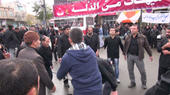 Ashura in Iran, men beating chests Stock Footage