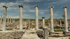 Remains of ancient greek columns against a blue sky in an ancient city Perge in Stock Footage