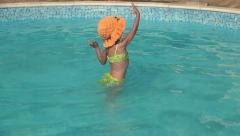 Child Playing with Ball in Swimming Pool, Girl, Kid Bathing, Splashing in Water Stock Footage