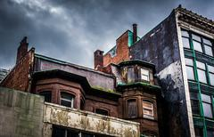 Dark clouds over run-down buildings in boston, massachusetts. Stock Photos