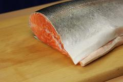 Stock Photo of Trout on the wooden board