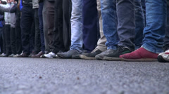 Feet and legs of men taking part in Ashura parade, Iran Stock Footage